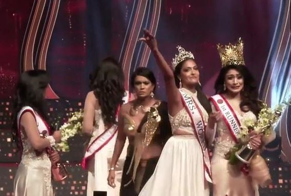 Update: Mrs. World arrested for allegedly injuring Mrs Sri Lanka after ripping crown from her head on stage over divorce claims