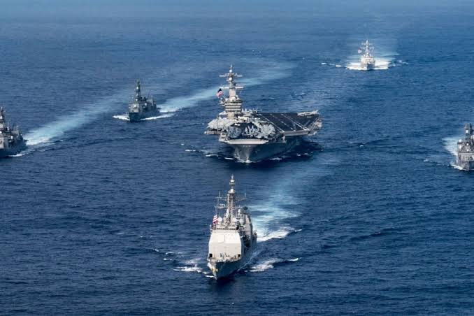 US and China deploy aircraft carriers and assault ships in South China Sea at the same time as tensions continue to grow