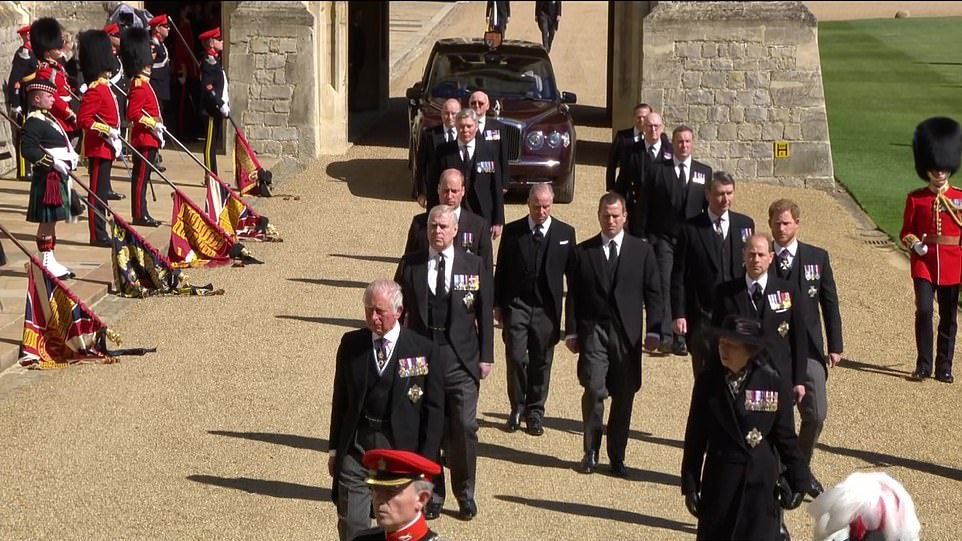 Prince Andrew wears a suit to Philip