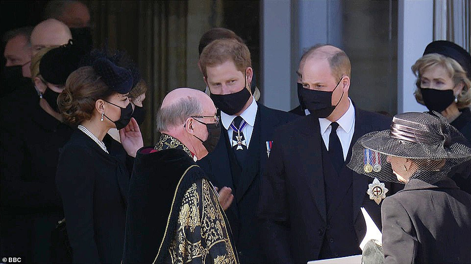 Prince William is pictured speaking to his estranged brother Harry in sign of reconciliation after their grandfather