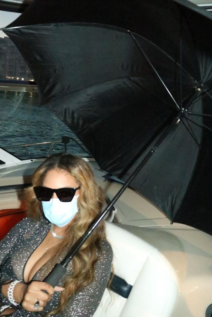 Beyonce flaunts curves in sheer gown with racy cut-outs and a plunging neckline as she lounges on a boat with close friends in Miami