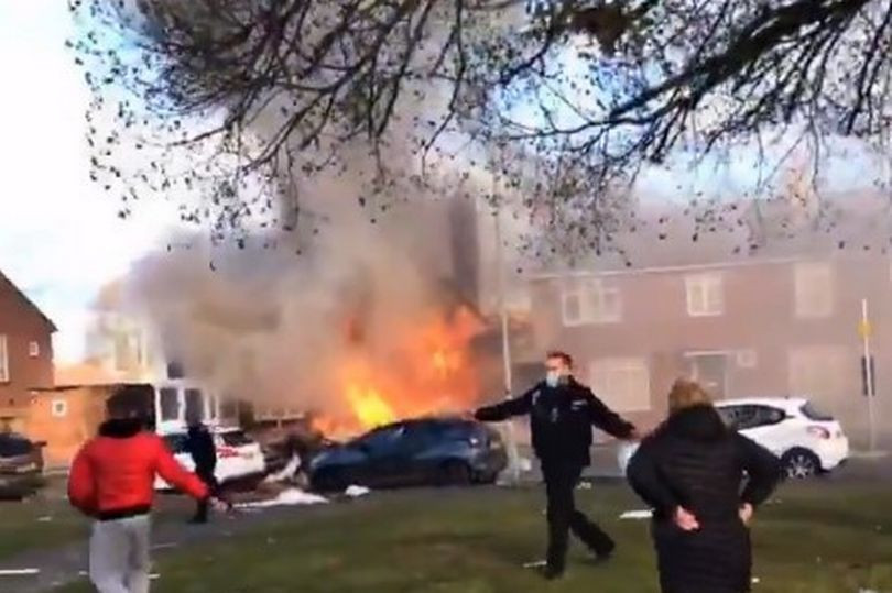 'Gas explosion' sees house engulfed in flames with people trapped inside building. 6