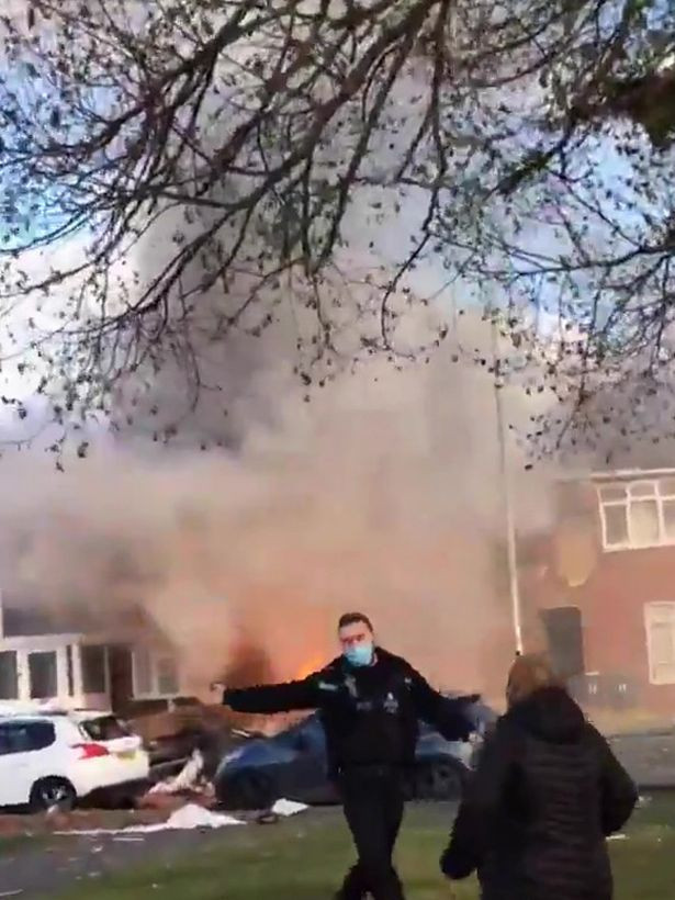 'Gas explosion' sees house engulfed in flames with people trapped inside building. 7