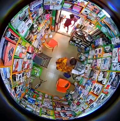 CCTV captures moment woman steals a storekeeper