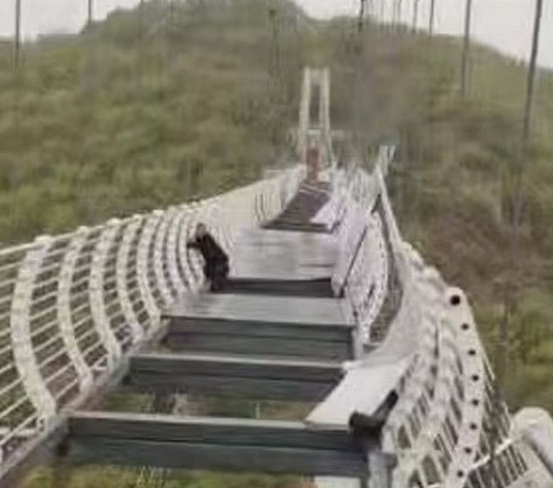 Terrified man left dangling 330ft above ground as glass bridge shatters