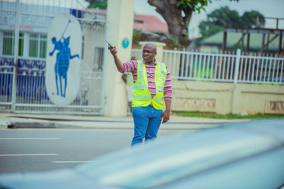 Billionaire businessman, Markson Ijiomah spotted controlling traffic in Port Harcourt