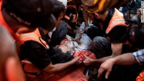 Terrifying scenes in Gaza as Israel-Palestinian conflict marks its deadliest day (photos)