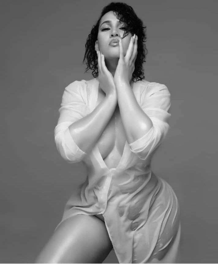 Actress, Caroline Danjuma sends pulses racing as she puts her boobs on display while posing in sheer shirtdress