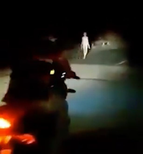 'Alien' figure with long limbs seen walking along bridge in the middle of the night