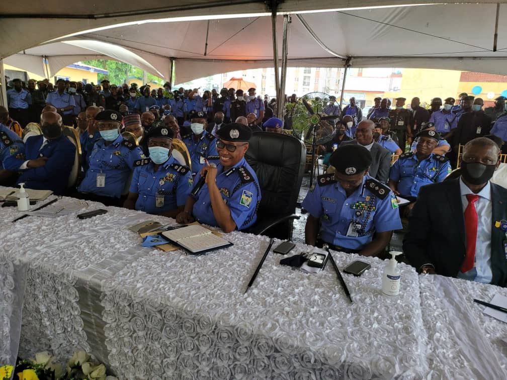 Officers and guests run for safety as heavy wind disrupts reception organized for IGP Baba