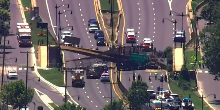 5 people hospitalized after pedestrian bridge collapses onto DC highway (photos)