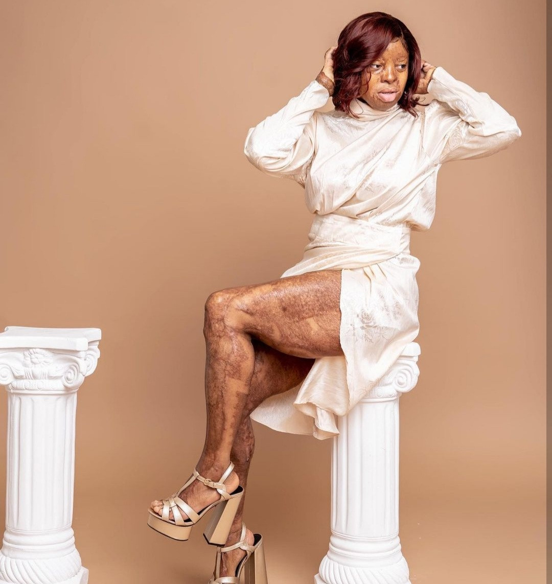 """""""Legs out"""" Kechi Okwuchi says as she shows off her legs in a dress with thigh-high slit"""