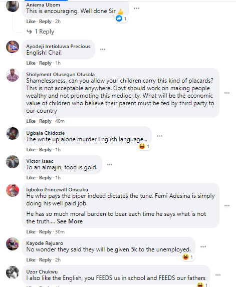 Femi Adesina shares photo of Katsina pupils carrying cardboard with grammatical blunders as they praised President Buhari for feeding them and their fathers