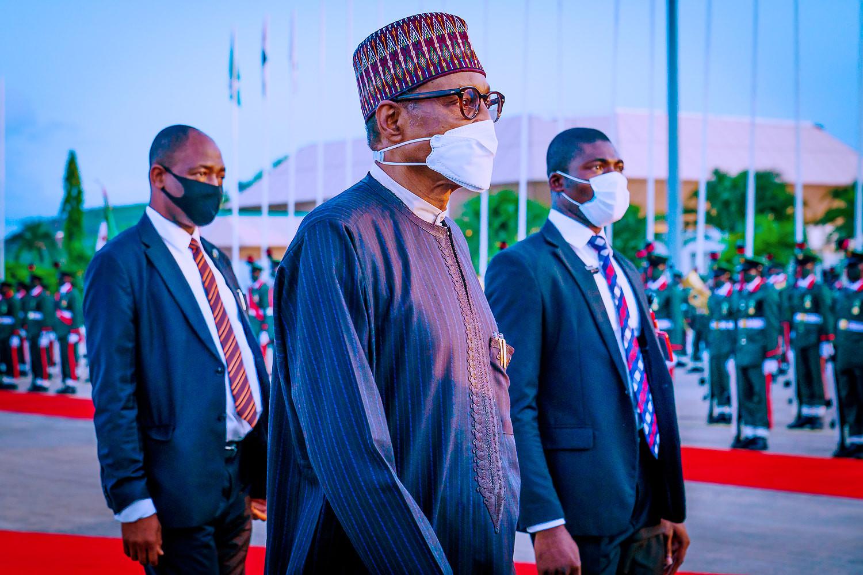 President Buhari returns to Nigeria from UK trip (photos)