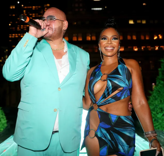 Ashanti leaves little to the imagination as she steps out in a revealing dress