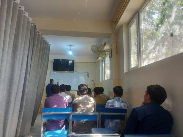 Afghan universities under Taliban rule separates male and female students with curtain