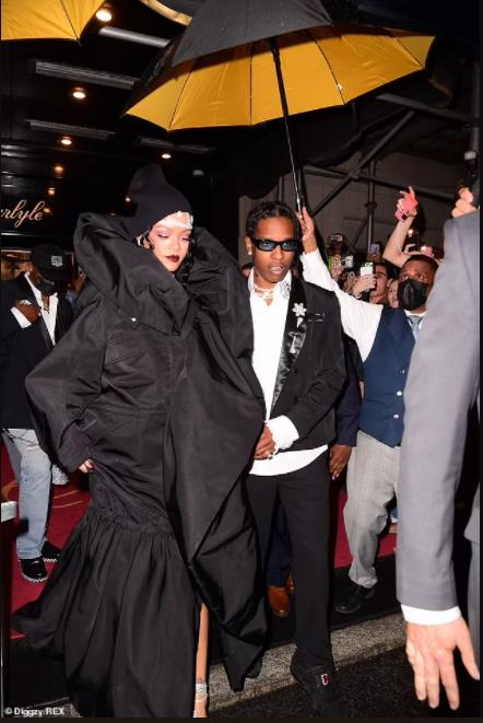Rihanna rocks billowing black coat dress as she and boyfriend A$AP Rocky share a kiss at Met Gala (photos)