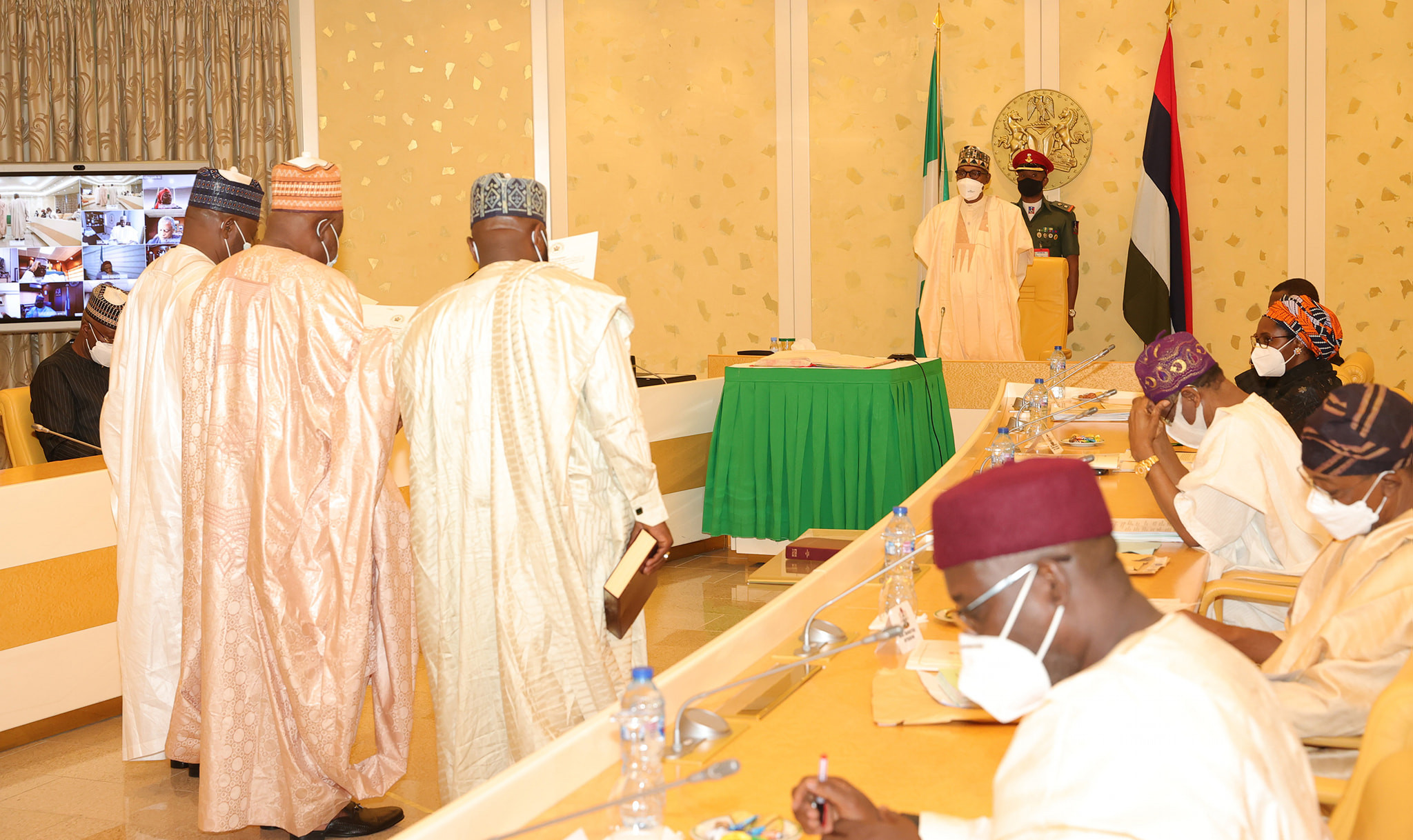 President Buhari swears in three new INEC National Commissioners