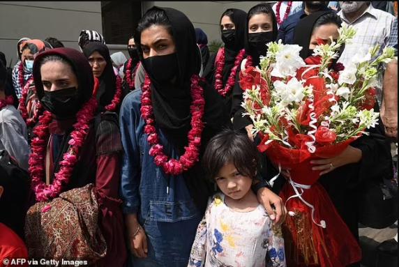 Afghanistan?s girl?s football teams flee across the border to Pakistan wearing burqas