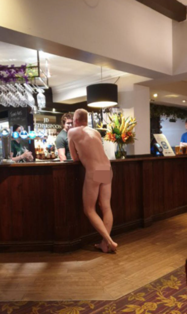 Man without a single piece of clothing spotted drinking at pub