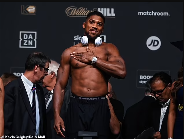 Anthony Joshua weighs in 19lbs heavier than Oleksandr Usyk ahead of their heavyweight title fight tomorrow (photos)