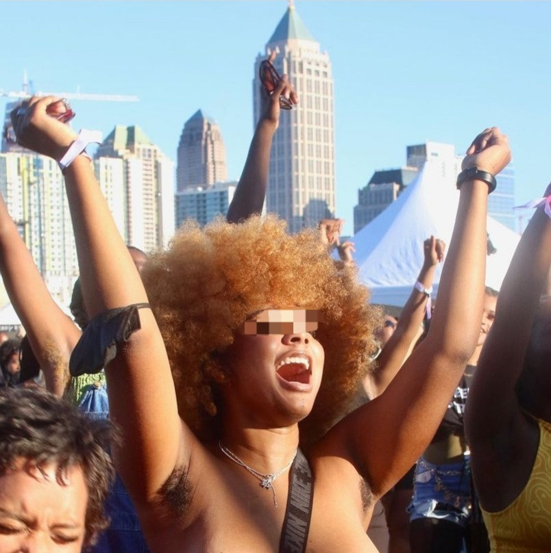 Topless woman with hairy armpit steals the show at Afropunk ATL 2021