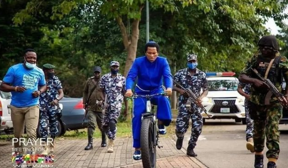 Trending photo of Nigerian clergyman, Daniel Wiseman, and his security details