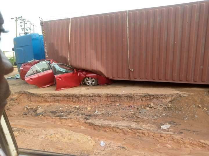 Occupants escape unhurt as container falls on vehicle in Nigeria