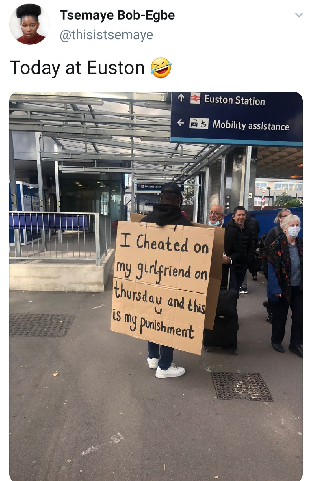 """Man seen in the streets of London wearing cardboard that reads: """"I cheated on my girlfriend and this is my punishment"""""""