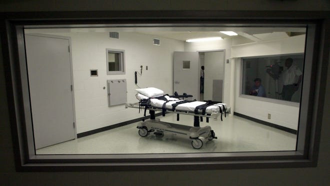 Man put to death by lethal injection for 1991 murder of woman who was abducted during robbery and killed in cemetery